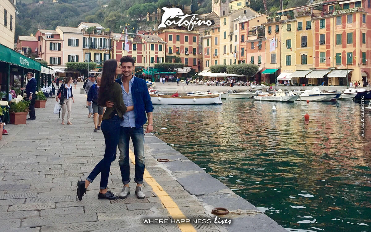 whispers I love you in Portofino walking in the Molo Umberto I. Pier on your right
